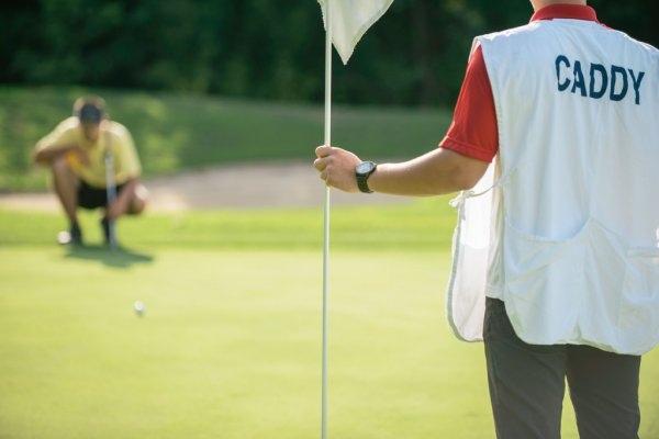depositphotos_110437660-stock-photo-golfer-putting-from-long-distance.jpg