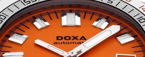 DOXA, oranžová hodinkám sluší